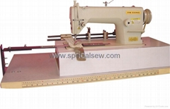 Single needl pin tuck sewing machine with rear puller