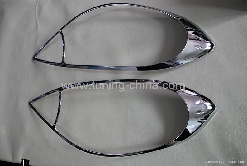 Almera 2011  headlamp trim 1