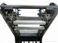 Tilted-arm vacuum table screen printer
