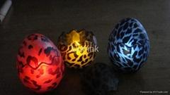 led candle in eggshaped glass-aniamal
