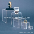 acrylic riser  display stands-Acrylic Risers  Proudly and securely display collectibles, miniatures, models, dolls, awards and trophies with our Rectangular Acrylic Risers. They elevate your favorite treasures to keep them completely visible.