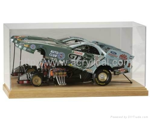 The Deluxe Acrylic 1:18 Scale Car Display Case features a black base with gold risers, clear cover, and a mirrored back. The acrylic displays contain U.V. absorbers to help protect your memorabilia from ultraviolet yellowing. Use this product to protect, store and display your collectible diecast cars from NASCAR, IRL, CART, Formula 1 and others.  Holds a 1:18 scale die cast car  Made of high clarity acrylic Exterior:  13 11/16 X 8 1/2 X 6 1/4  Interior:  12 7/8 X 6 7/16 X 4 1/2  UV Protection  Car & Nameplate not included