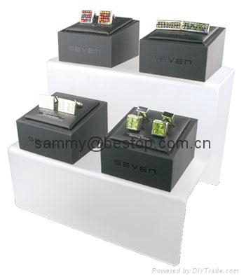 Riser-Acrylic Risers  Proudly and securely display collectibles, miniatures, models, dolls, awards and trophies with our Rectangular Acrylic Risers. They elevate your favorite treasures to keep them completely visible.