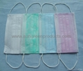 Surgical nonwoven face mask