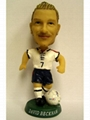 Football player bobblehead doll