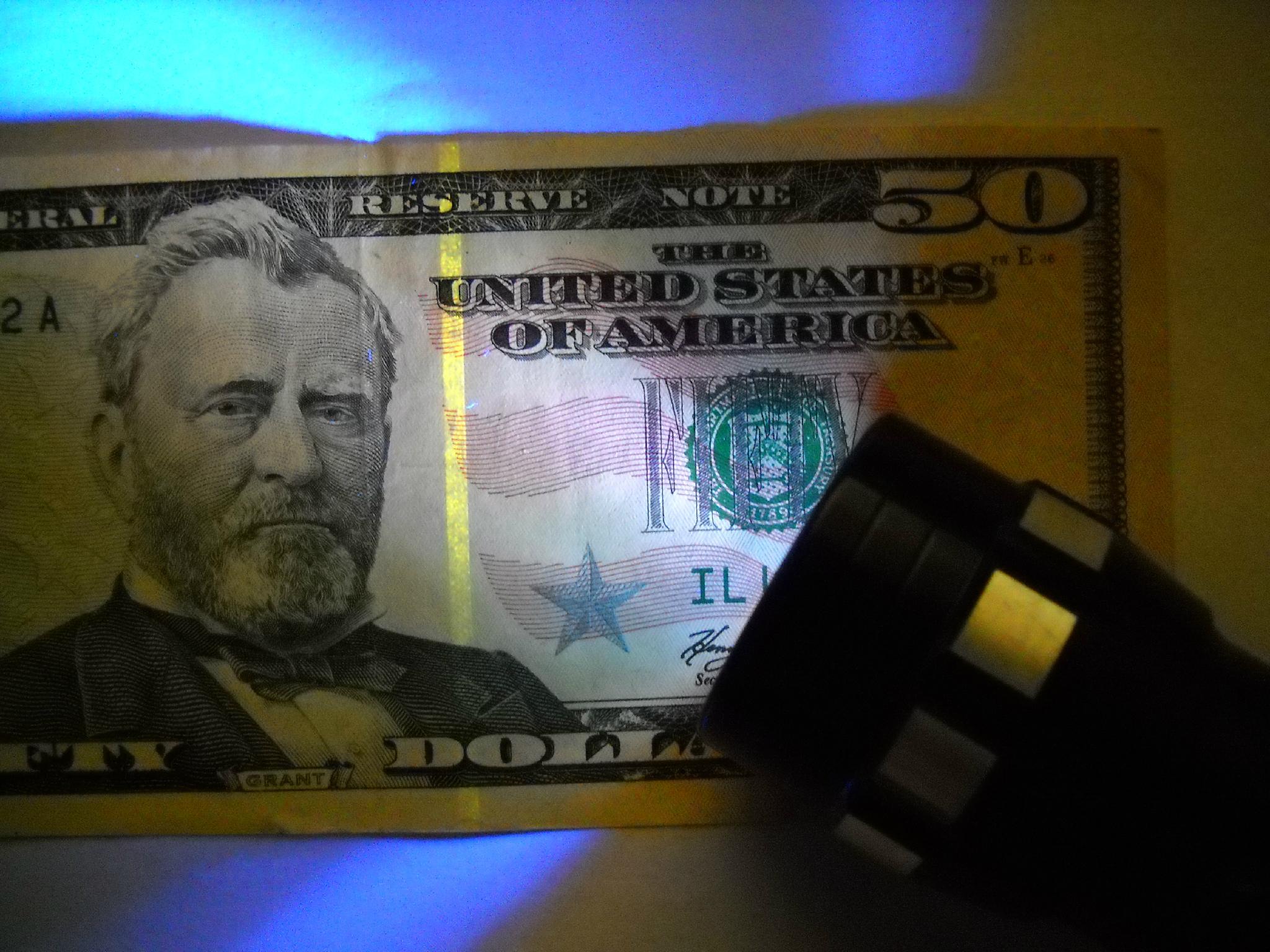 紫光防偽驗鈔手電筒 2