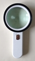 Handheld magnifier with  LEDs