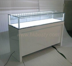 Glossy white jewelry showcases for