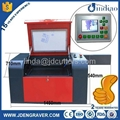 Economy mini desktop small cheap low cost laser engraving cutting machine price