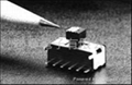 Slide switch with pushbutton feature