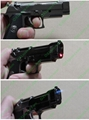 Gun style cigerettes lighter with a 5mw red laser pointer sight FREE SHIPPING