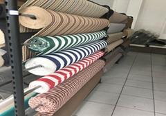 Polyester yarn for Oxford yarn-dyed fabric