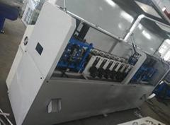 全自动数控镀锌包边钢带包装箱生产设备
