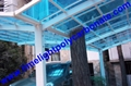 Double aluminium carport with white frame and blue polycarbonate solid roofing 4