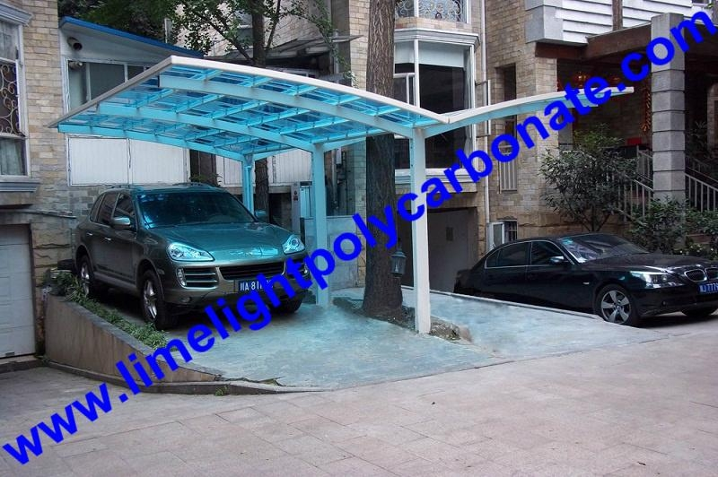 Double aluminium carport with white frame and blue polycarbonate solid roofing 2
