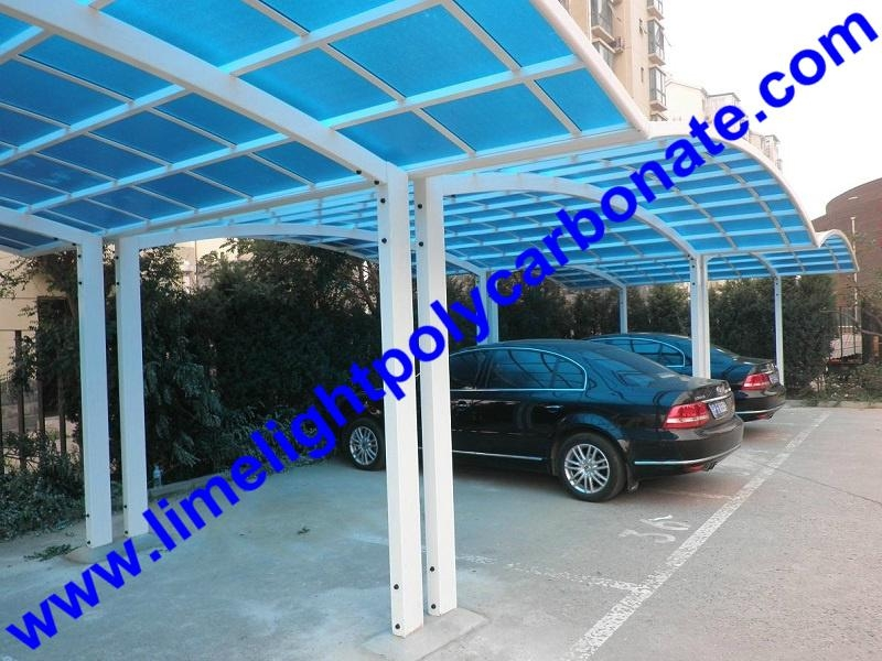 Double aluminium carport with white frame and blue polycarbonate solid roofing 6