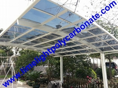 White aluminium frame and light grey polycarbonate solid sheet aluminium carport