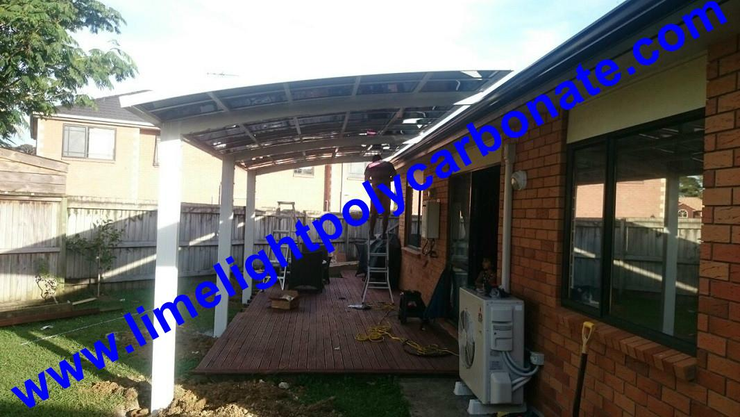 Double aluminium carport with white frame and blue polycarbonate solid roofing 12