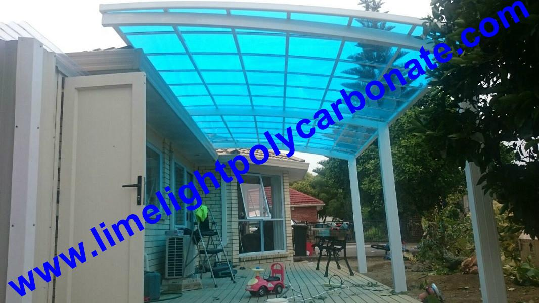 Double aluminium carport with white frame and blue polycarbonate solid roofing 13