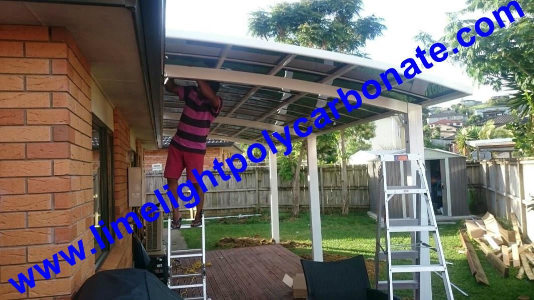 Double aluminium carport with white frame and blue polycarbonate solid roofing 14
