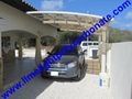 Double aluminium carport with white frame and blue polycarbonate solid roofing 16