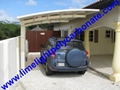 Double aluminium carport with white frame and blue polycarbonate solid roofing 17