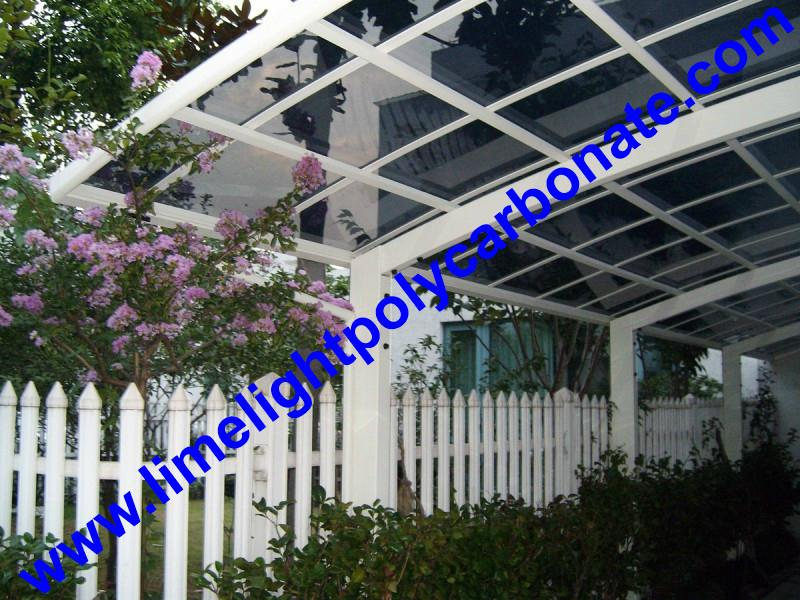 single aluminium awning with white frame and bronze polycarbonate solid roofing 4