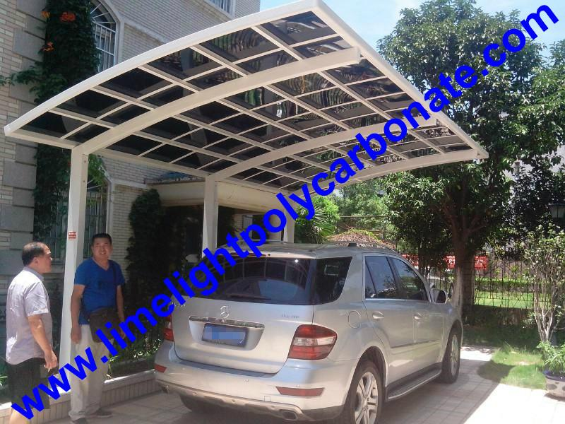 single aluminium awning with white frame and bronze polycarbonate solid roofing 9