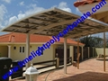single aluminium awning with white frame and bronze polycarbonate solid roofing 11
