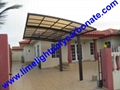 single aluminium awning with white frame and bronze polycarbonate solid roofing 12